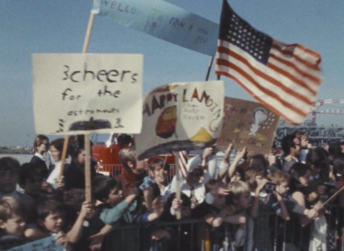 A crowd greets the Apollo 11 astronauts in France.