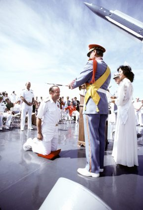 RADM William A. Walsh, commander, Amphibious Group Eastern Pacific, is knighted on board the guided missile cruiser USS LEAHY (CG-16) during ceremonies by the Sea Fair royalty (1982). Local Identifier: 330-CFD-DN-ST-83-01285 (https://catalog.archives.gov/id/6371855)