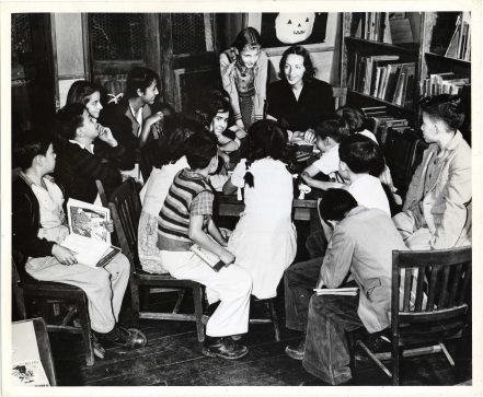 Story Hour in Spanish, Mexico. Miss Raquel Viliesid, Assistant in the children's room of the BBF, engaged in a regular Friday afternoon activity, the story hour in Spanish.(306-CS-6N-10) https://catalog.archives.gov/id/23932422