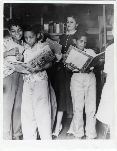 Showing Children's Books to Boys in Bookmobile, Panama City (306-CS-6Q-3) https://catalog.archives.gov/id/23932432