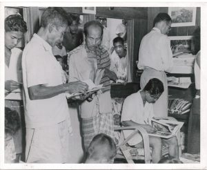 USIS Bangkok, Thailand, Boatmobile. A large group of people aboard the boatmobile wherever it stopped, eager to read the many publications available to them (306-8C-2)
