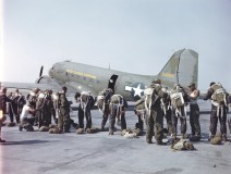 342-C-K3711 NAID: 148728114 Original Caption: Operation Firefly - Paratroopers of the 555th Parachute Infantry climb into their parachute harness before boarding a plane of the First Troop Carrier Command. The C-47 will drop the airborne fire fighters near an area where a forest fire is raging. Umatilla National Forest, Oregon.