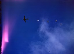 342-C-K3739 NAID: 148728156 Original Caption: Operation Firefly - The firemen come by air: five paratroopers of the 555th Parachute Infantry Battalion hit the silk on their wat to fight a fire in the Umatilla National Forest, Oregon.