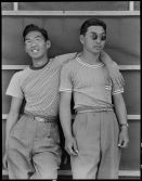 """Original Caption: """"Sacramento, California. College students of Japanese ancestry who have been evacuated from Sacramento to the Assembly Center."""" Photographer: Dorothea Lange. Date: May 20, 1942. Local ID: 210-G-C471 (NAID 537785)"""