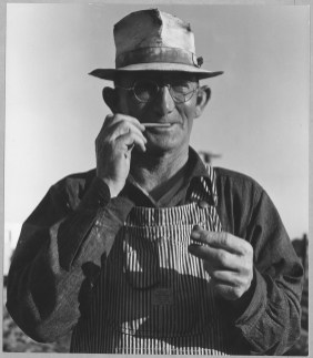 """Original Caption: """"Olivehurst, Yuba County, California. One of the new settlers."""" Photographer: Dorothea Lange. Date: March 19, 1940. Local ID: 83-G-41344 (NAID 521585)"""