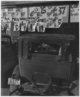"""Original Caption: """"Coolidge, Arizona. Indians, Negroes, Mexicans, and white Americans buy food, clothing, and seek recreation in town on Saturday afternoon."""" Photographer: Dorothea Lange. Date: November 1940. Local ID: 83-G-44343 (NAID 522512)"""