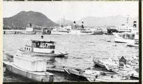 """Local Photo ID: 243-HP-I-52 (NAID 175739147). Original Caption: """"This relatively small harbor was developed as port for the city of Hiroshima, and has been one of the principal embarkation depots for the Japanese Army since the Sino-Japanese War. Only 20 percent of the harbor facilities were available for civilian activities. One of the important functions of Ujina Harbor was to act as the base for trade and communications with the Matsuyama area on the island of Shikoku. Passenger steamers plying between Hiroshima, Osaka, Etajima, and various ports on Shikoku and Kyushu stopped here. Fish is a Japanese dietary staple, and a fishing fleet based in Ujina Harbor operated on the Inland Sea. The harbor was never open to ships of foreign countries, but reports show that foreign trade amounting to about 500,000,000 yen was handled at the port by Jap ships in 1935."""""""