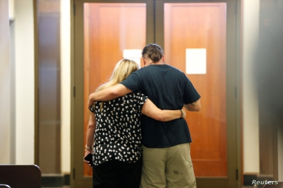 Mary and Alberto Vega, family members of Ghost Ship fire victim Alex Vega, embrace each other after a jury came to a hung jury on master tenant Derick Almena and acquitted friend Max Harris of involuntary manslaughter that killed 36 people in 2016, in Oakland, California, U.S., September 5, 2019. REUTERS/Stephen Lam