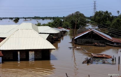 FILE - Houses partially submerged in flood waters are pictured in Lokoja city, Kogi State, Nigeria, Sept. 17, 2018.