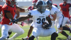Redshirt junior Jereke Armstrong leads the team in rushing.  Photo Courtesy of USD Athletics