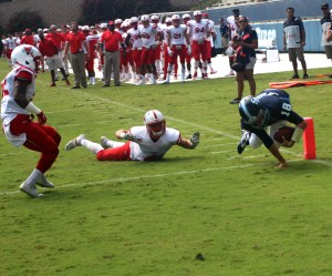 Redshirt freshman quarterback Anthony Lawrence scampers into the end zone against Marist. Ian Lituchy/The USD Vista
