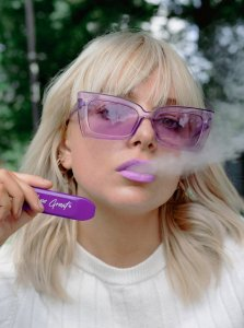 vaping girl with the IVG Bar Disposable Pod Device