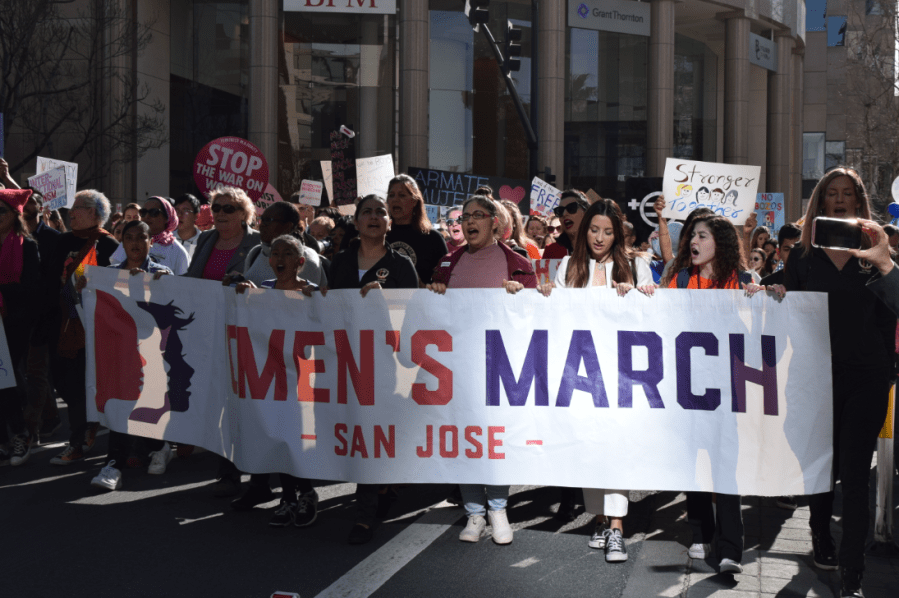 As protesters round Santa Clara St. during the Womens March, their chanting fills the silence of the morning.