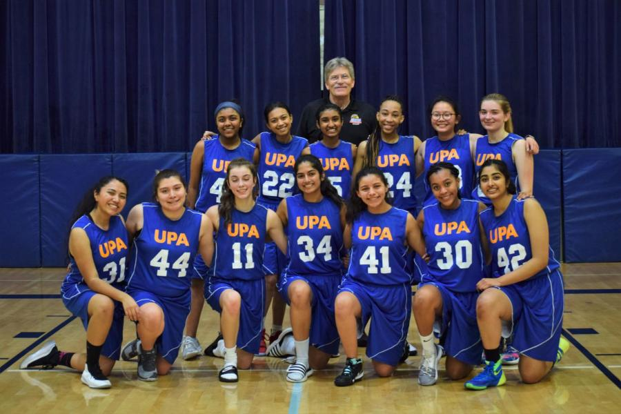 The team poses for a photo after the game.