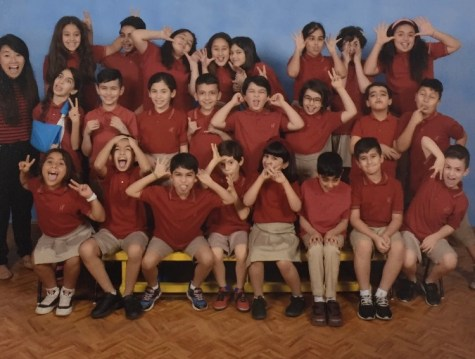 Siu takes a silly classroom picture with her fourth grade students in 2018 at Kuwait American School.