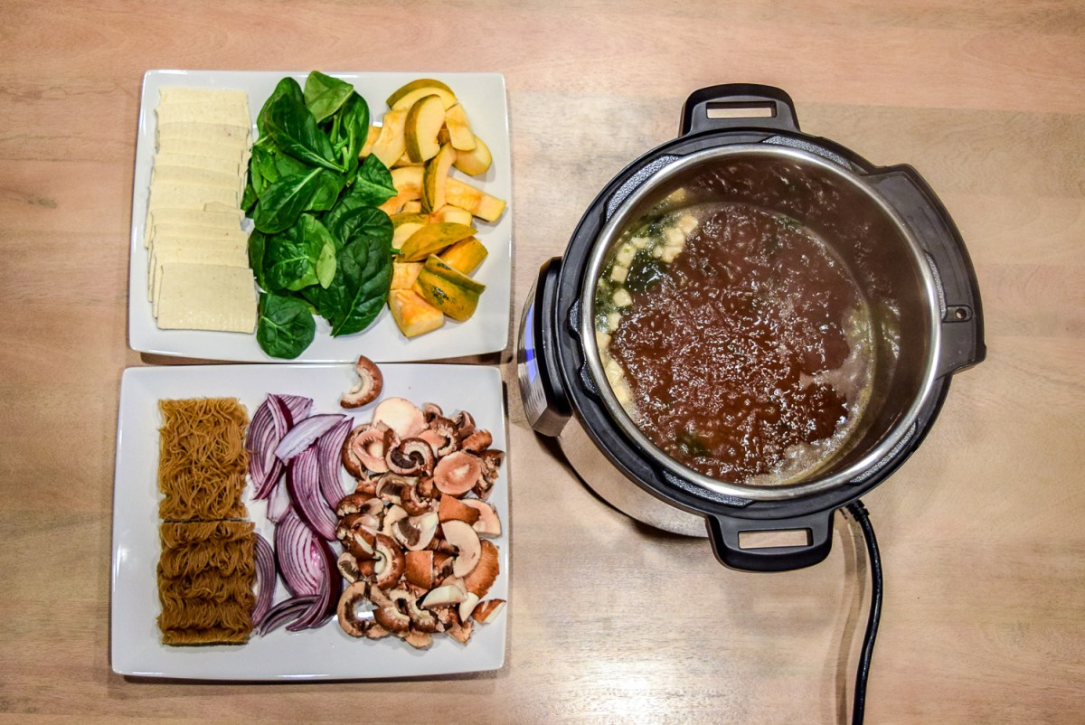Instant Pot Hot Pot with Vegetables, Tofu, and Ramen Noodles boiling from top