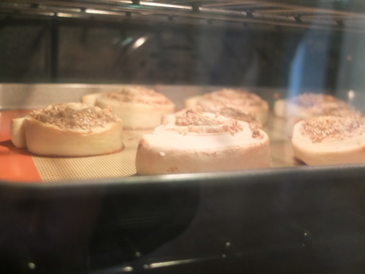 Sesame Schnecken Rolls with Orange Glaze baking in the oven