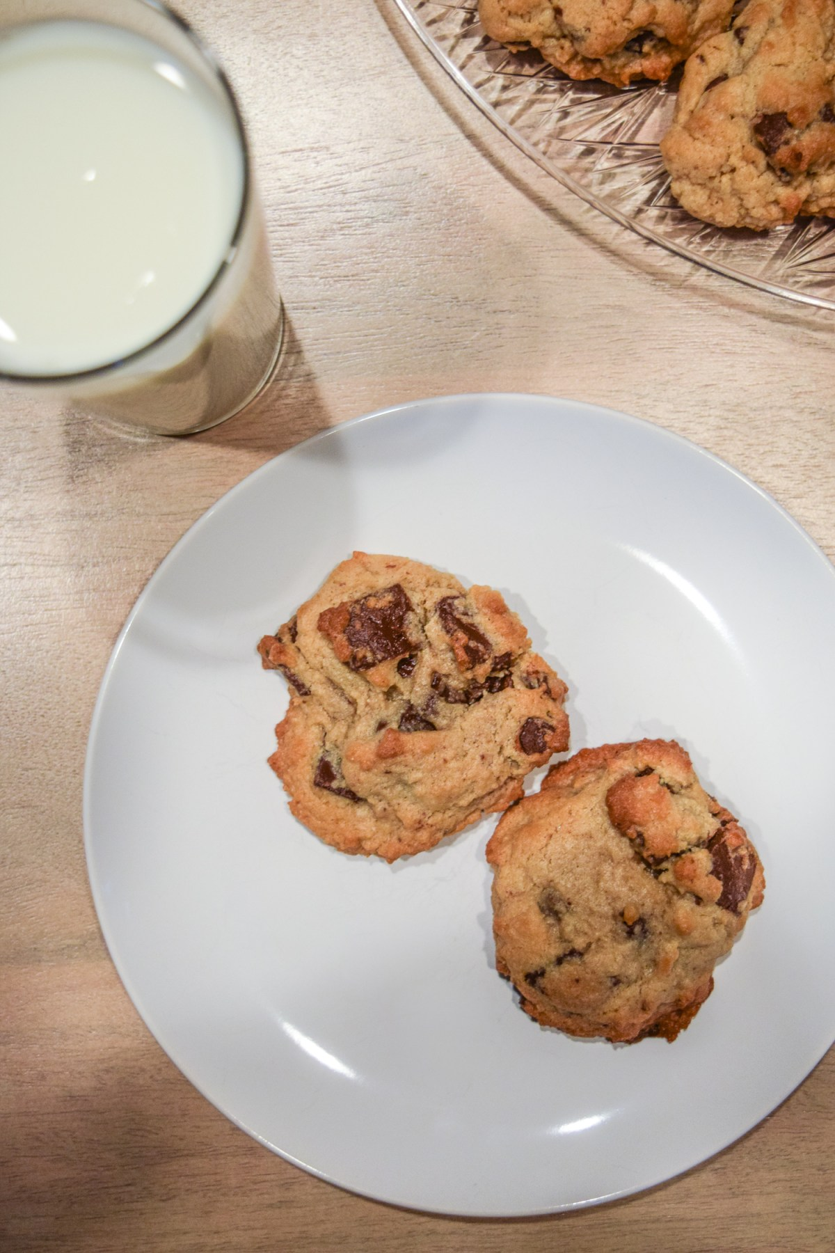 Specialty's Semi-Sweet Chocolate Chunk Cookies with glass of milk from above