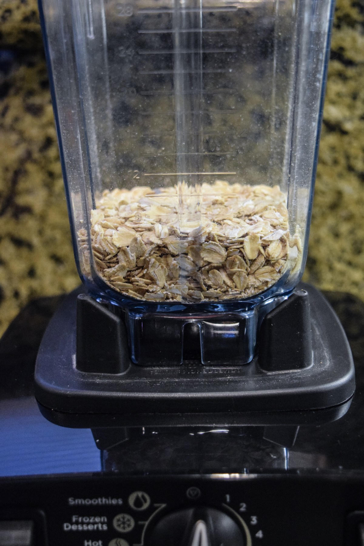 Oats in Vitamix dry grains container from the side