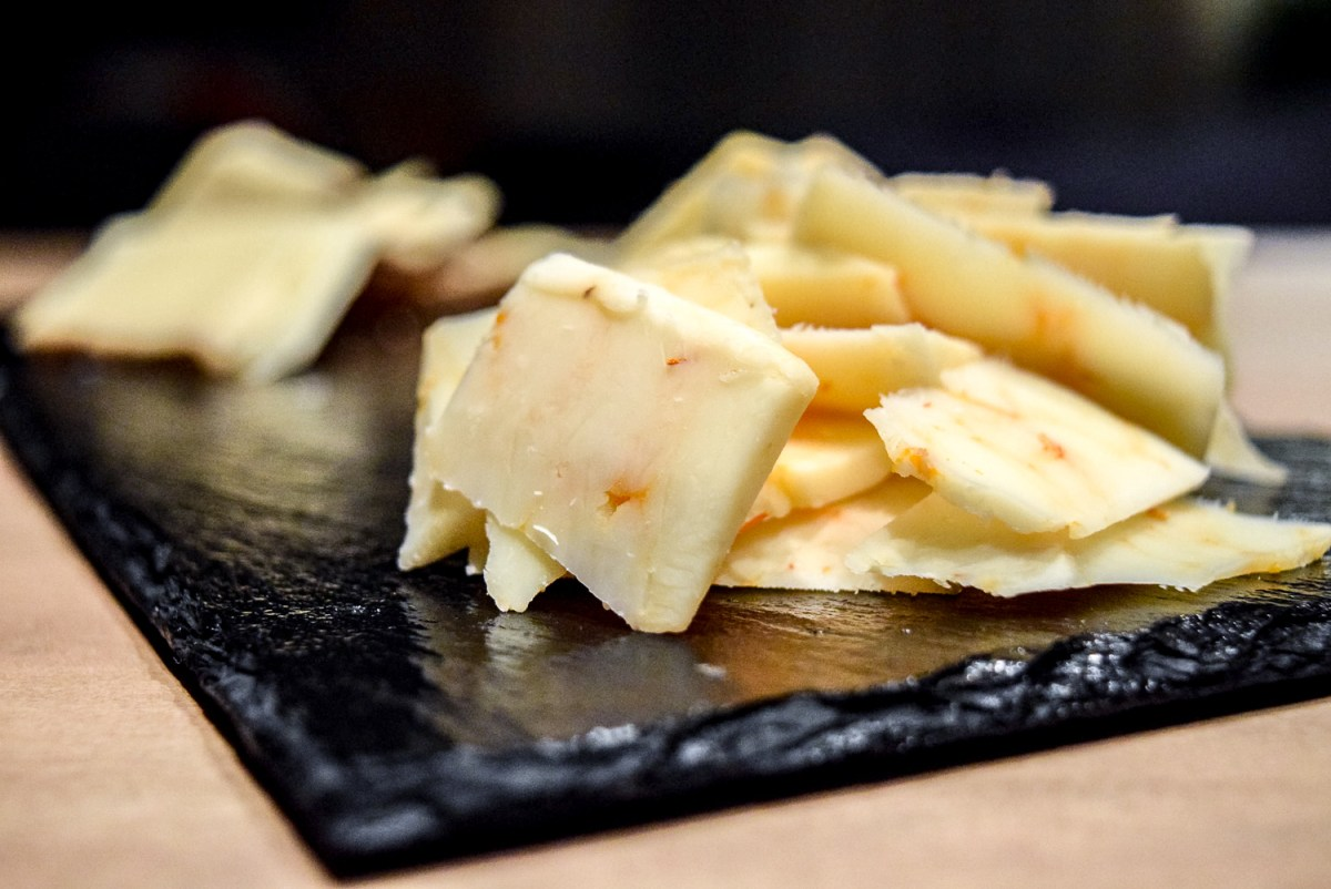 Close up on Trader Joe's Ghost Pepper Cheddar on Gluten-Free Peppery Slate Cheeseboard