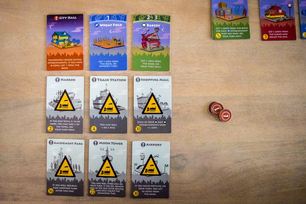 Initial personal city cards while playing Machi Koro: Bright Lights, Big City from top