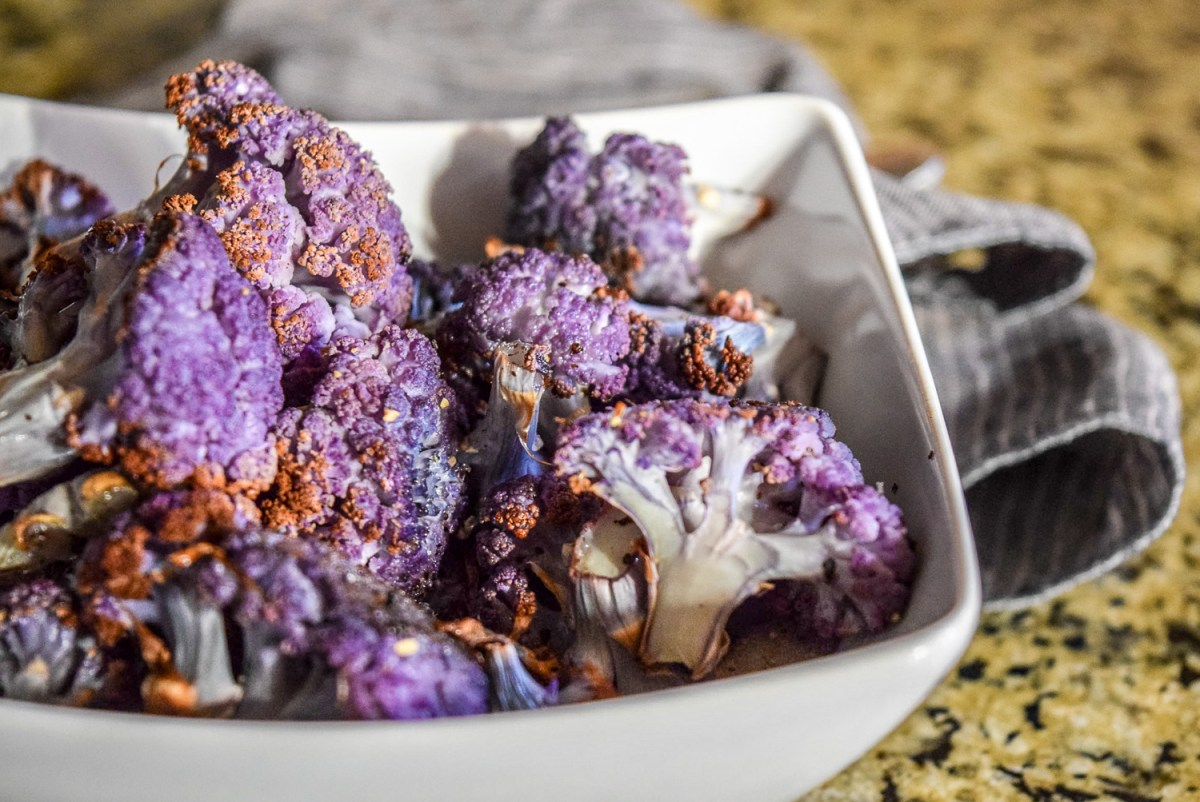 Finished roasted purple cauliflower florets up close