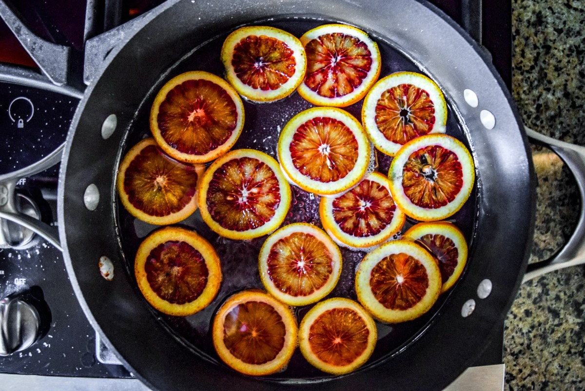 Blood orange slices in sugar water for candying from top