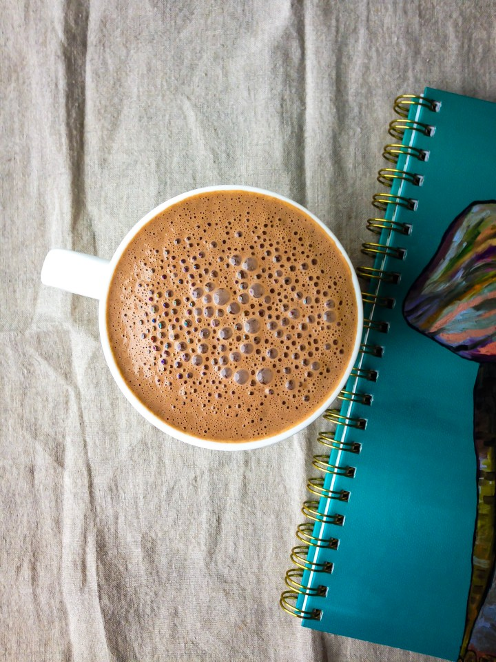 an overhead shot of a Mayan mocha made with cashews, cacao powder, cayenne, cinnamon, and sweetened with a date.