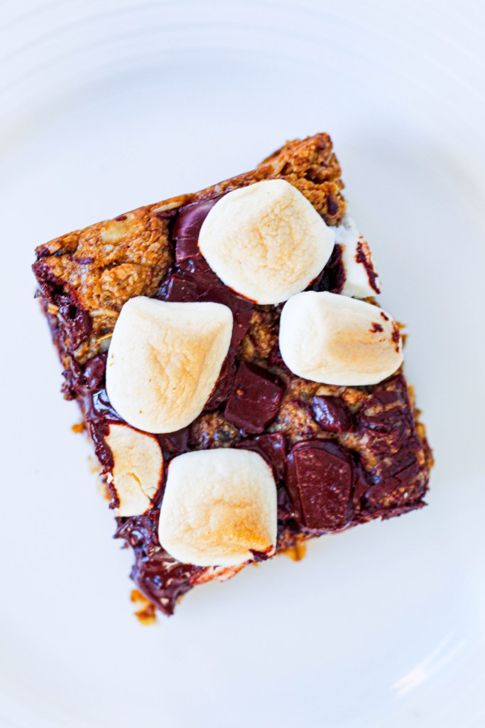 overhead shot of one s'mores bar on a white plate