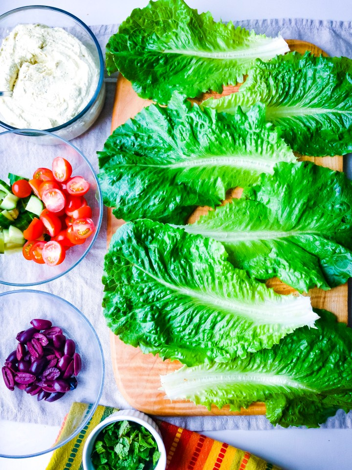 A platter filled with ingredients for raw romaine tacos with tofu ricotta