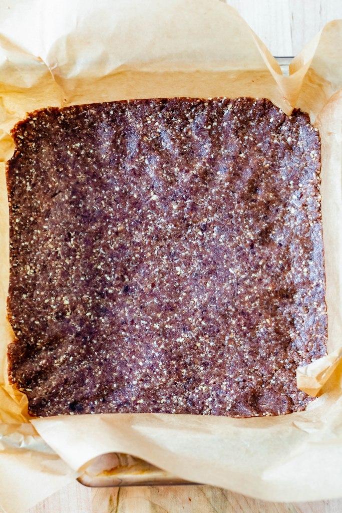 Raw Vegan Nanaimo Bar Recipe- the walnut date crust in the pan