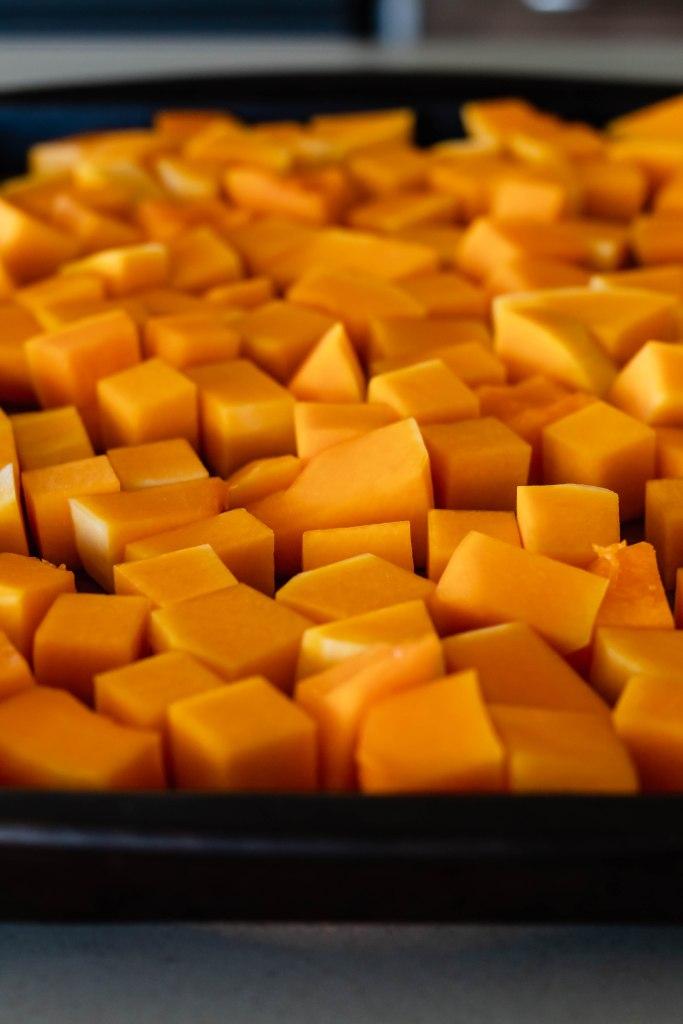 Vegan Butternut Squash Lentil Roti: Butternut squash on a pan to be roasted