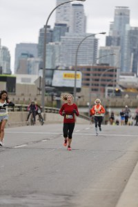 My Health Journey (recovery from anorexia- a photo of Allison, after recovering, running in the Toronto marathon)