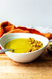 A bowl of winter glow cauliflower turmeric soup, topped with roasted chickpeas
