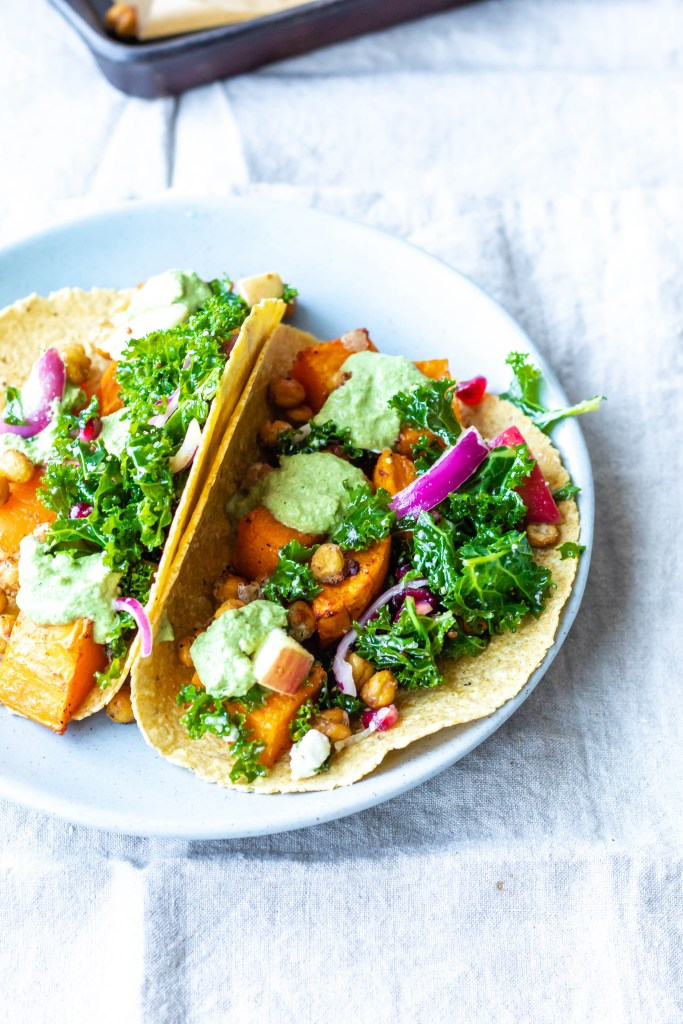 Two butternut squash and chickpea tacos on a plate