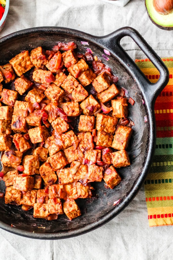 overhead shot of the barbecue tempeh in a cast iron skillet