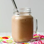 featured image for recipe showing a glass of coffee tahini cinnamon smoothie