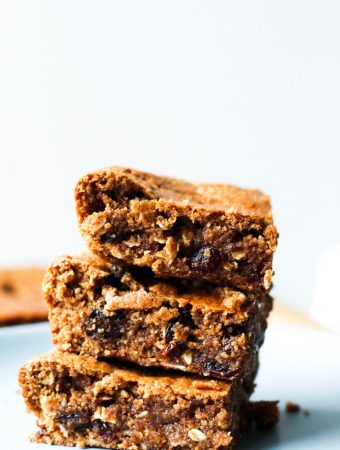 straight on shot of a stack of 3 vegan oatmeal raisin blondies