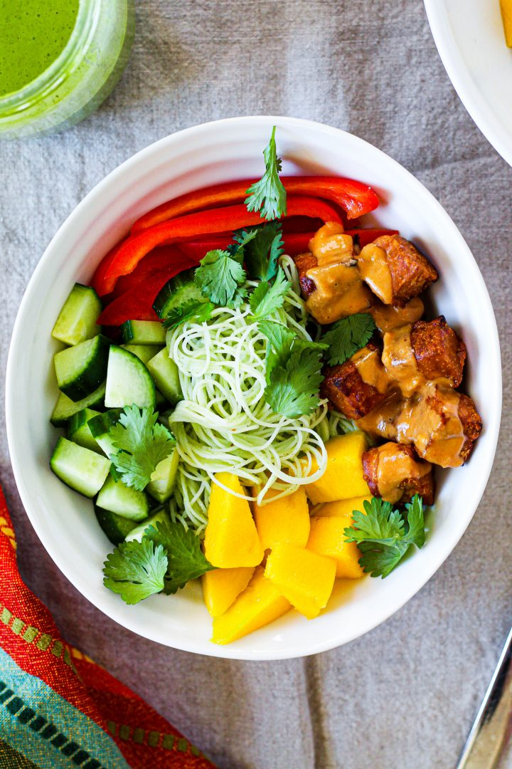 an overhead shot of a bowl of the Thai peanut tempeh salad in an individual bowl