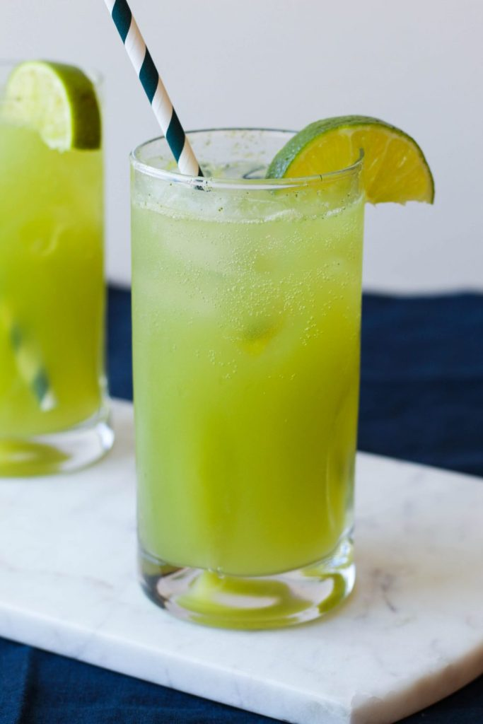 featured image for post showing straight on shot of a glass of sparkling limeade
