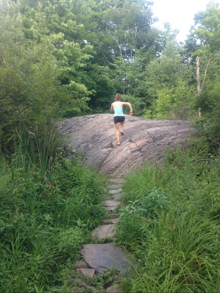 Allison running on a trail