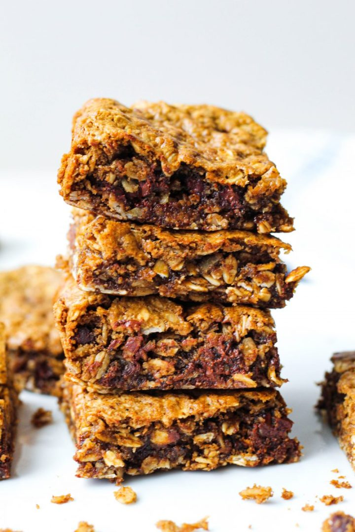 straight on shot of a stack of four chocolate hazelnut oat bars