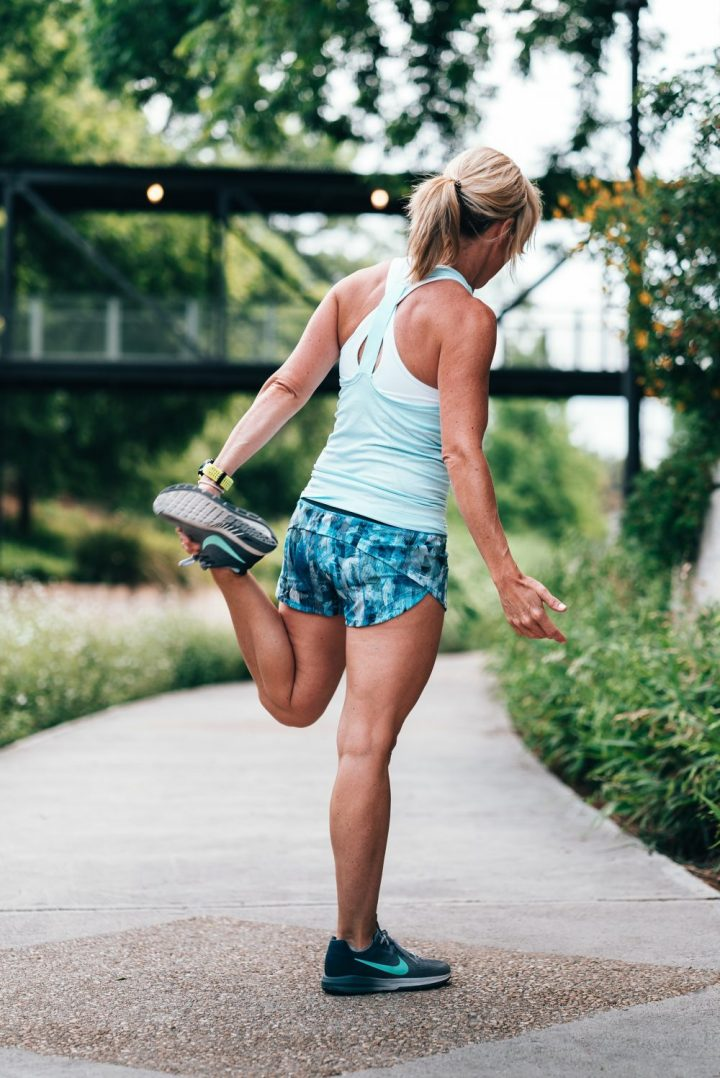 photo of a woman stretching during a run