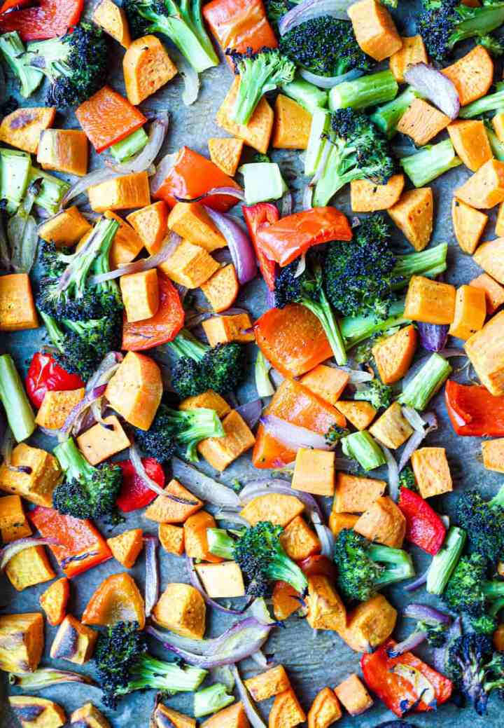 overhead shot of the roasted vegetables on a baking sheet