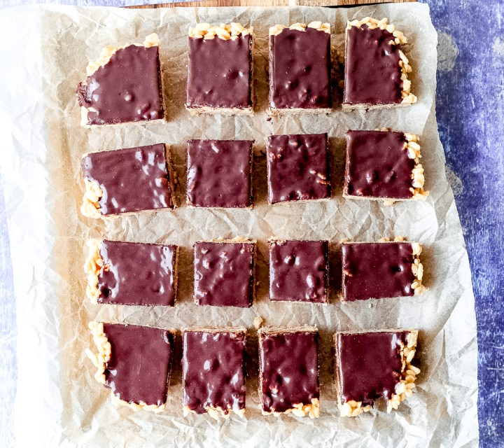 overhead shot of the full batch sliced into squares on a sheet of parchment