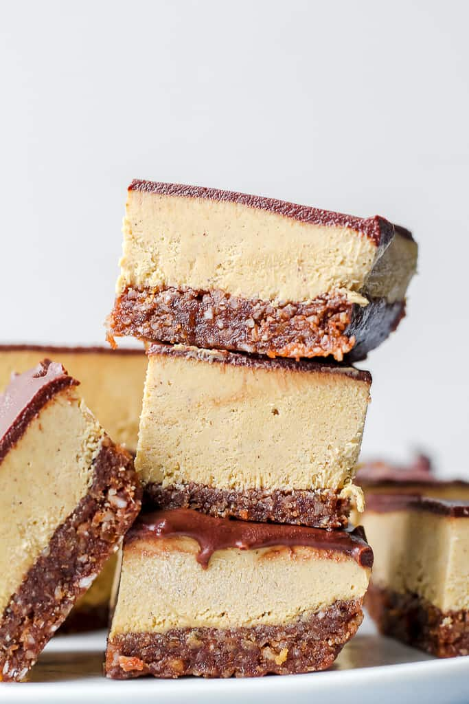 straight on shot of a stack of the Nanaimo bars on a white plate