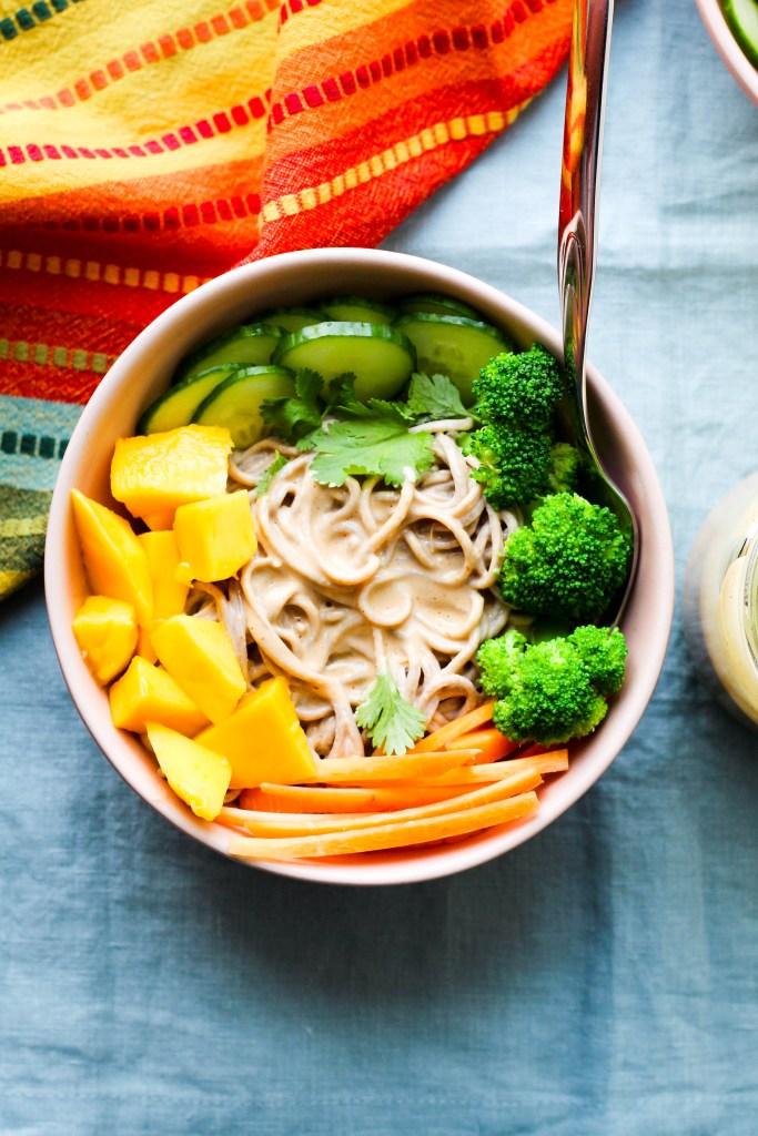 an overhead shot of a bowl of vegan peanut butter noodles