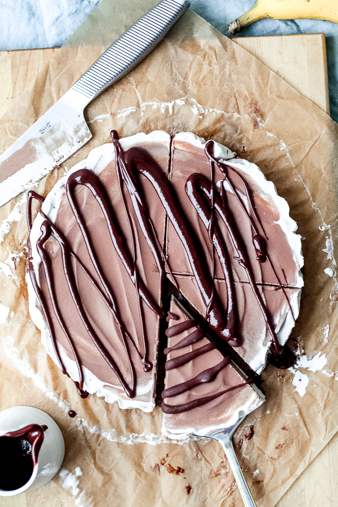 overhead shot of the whole vegan ice cream pie with to fudge drizzle over top