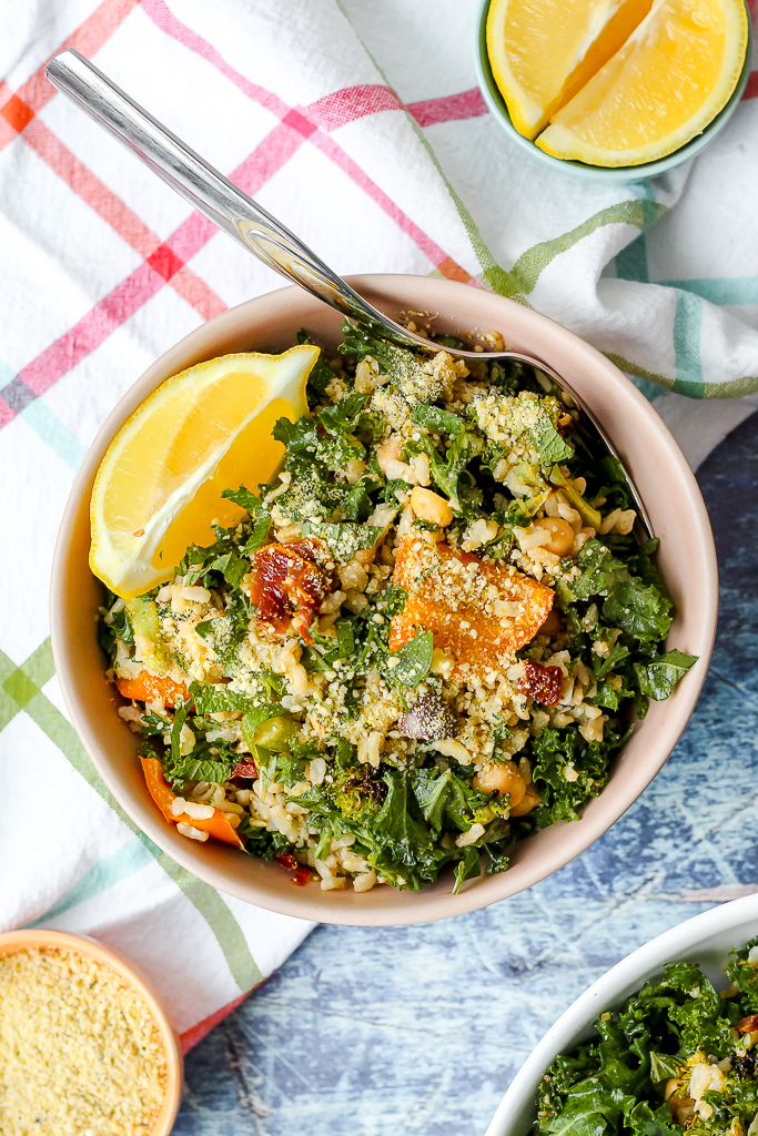 an overhead shot of a serving of brown rice broccoli chickpea salad in a pink bowl