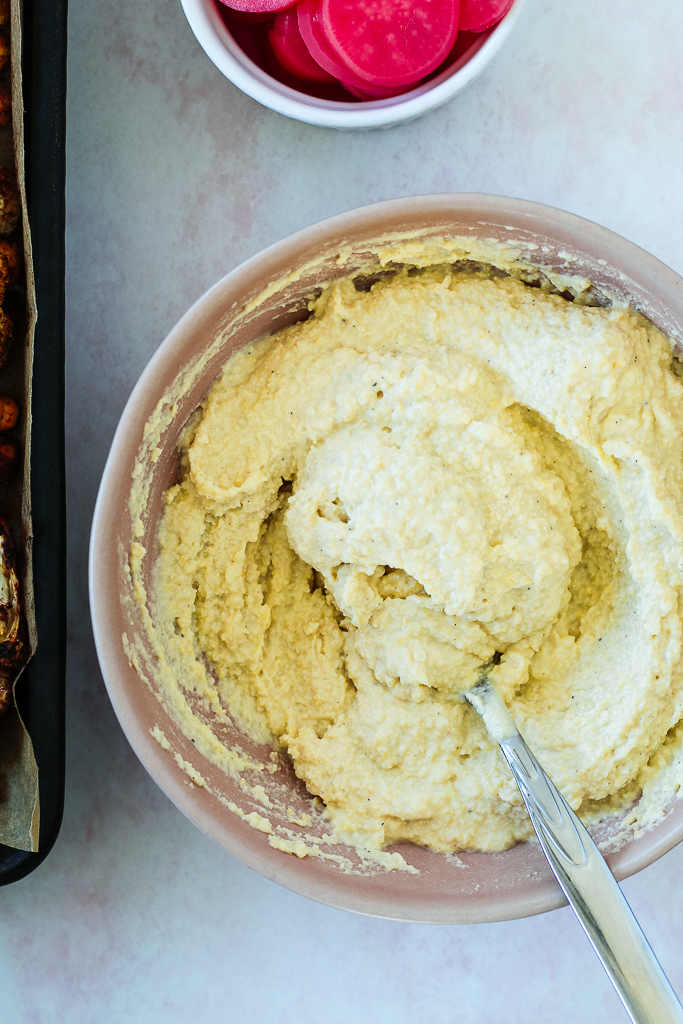 an overhead photo of the hummus in a pink bowl